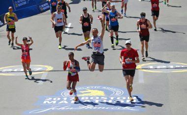 Boston, Massachusetts -- 4/17/2017 - Yuichiro Hidaka of Laramie, Wyoming leaps in the air before crossing the finish line of the 121st Boston Marathon. (Jessica Rinaldi/Globe Staff) Topic: Marathonpics Reporter: